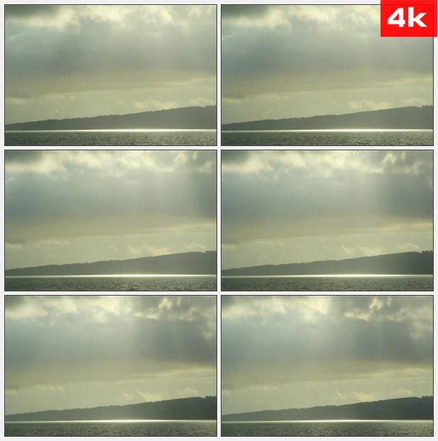 4K0073阳光透过乌云照射湖面 高清实拍视频素材