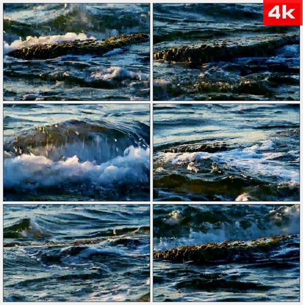 4K0084岩石上滚动的波涛 高清实拍视频素材