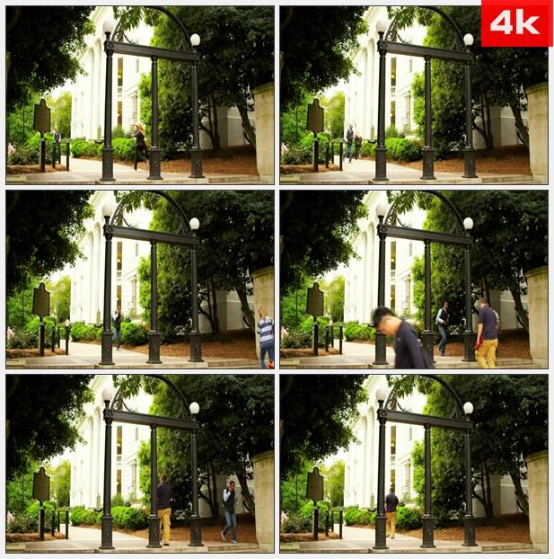 4K0099学生走过校园的拱门 高清实拍视频素材