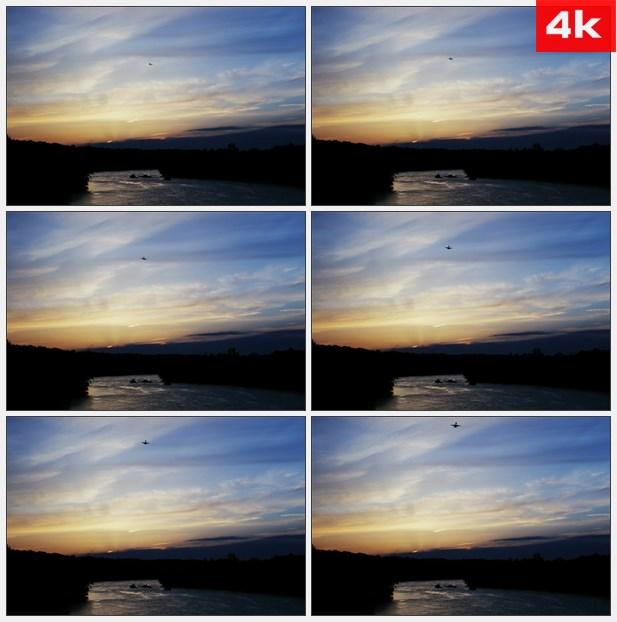 4K0243日落傍晚飞机飞过天空剪影 高清实拍视频素材