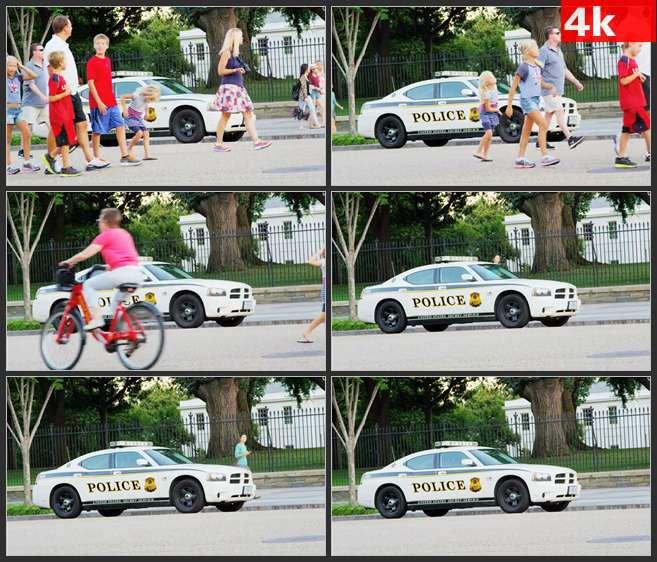 4K0494国外警车行人走过 高清实拍视频素材