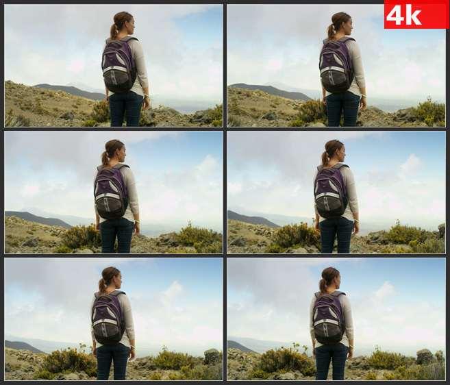 4K0669背包女游客在山顶上眺望 高清实拍视频素材
