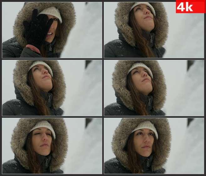 4K0674暴风雪中女人拭去头发漏出脸 高清实拍视频素材