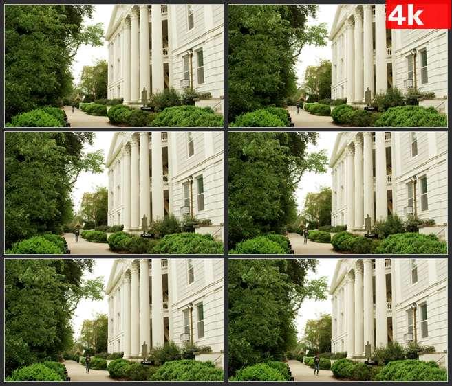 4K0697白建筑旁边走过的学生 高清实拍视频素材