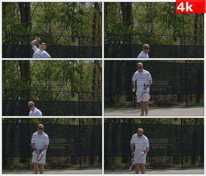 4K0845戴墨镜男子挥球拍发球打网球高清实拍视频素材