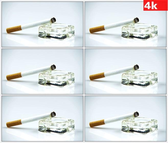4K0857点燃的香烟玻璃烟灰缸特写高清实拍视频素材