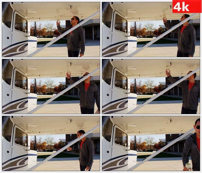 4K0892飞行员检查机翼里面流体高清实拍视频素材