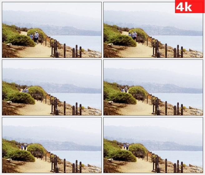 4K0960海岸边慢跑背影高清实拍视频素材