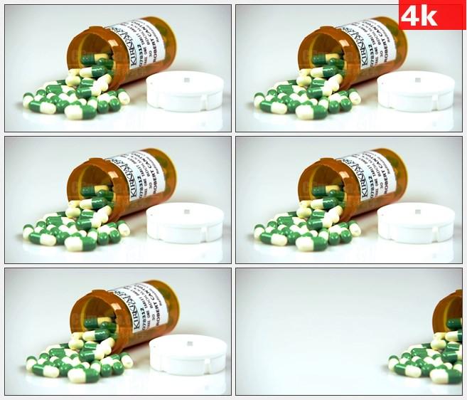 4K1107绿色白色胶囊药丸处方药瓶特写高清实拍视频素材