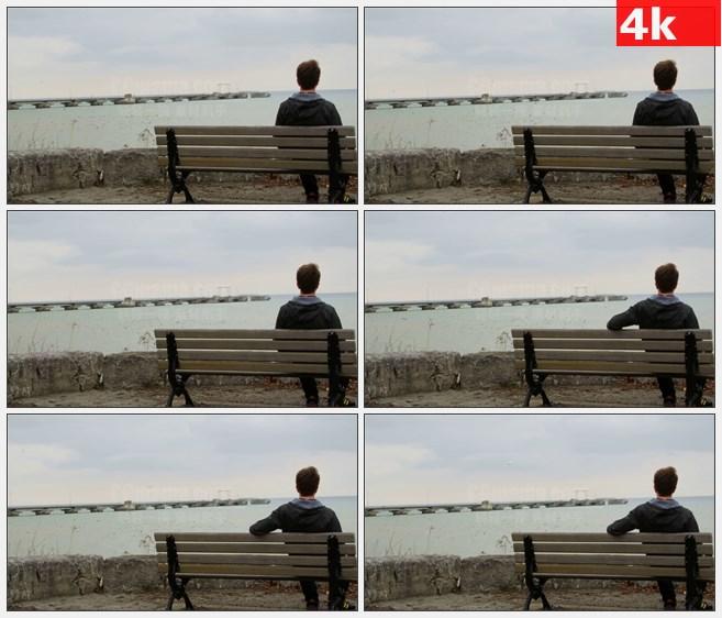 4K1339人坐在长凳上欣赏大海天空美景背景高清实拍视频素材