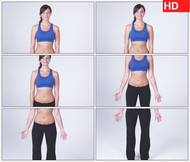 ZY1550穿着蓝色的运动胸罩和黑色裤子微笑的女人从腰上向下镜头移动特写高清实拍视...