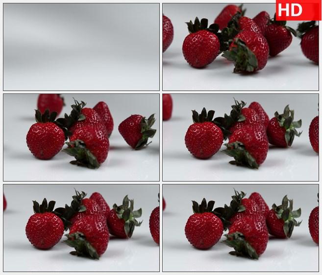 ZY1604红草莓掉到桌子上跳动滚动桌面特写高清实拍视频素材