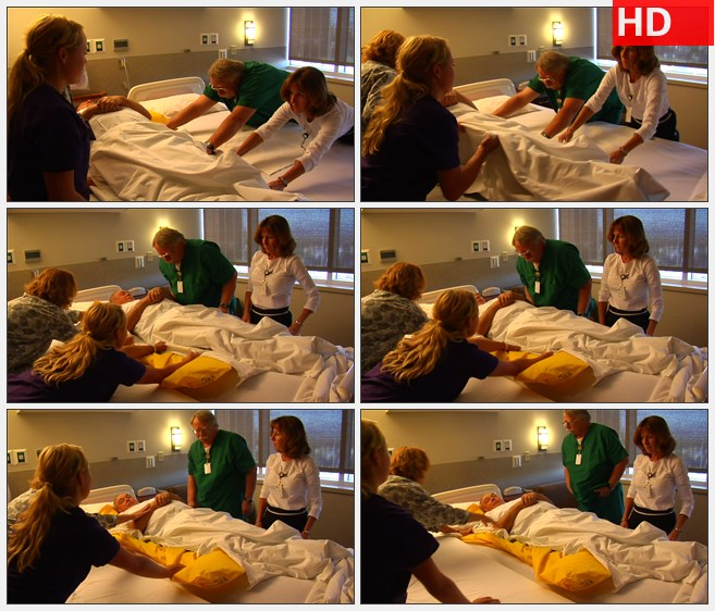 ZY1605护士们与家属移动老年患者从一张床到另一张床上高清实拍视频素材