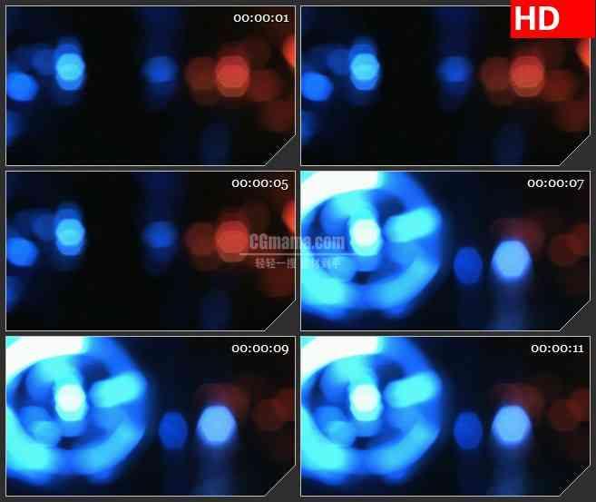 BG4614红色蓝色的旋转灯光模糊光影led大屏背景高清视频素材